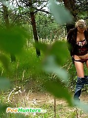 16 pictures - Tall slim babe gets busted urinating in the bush