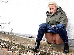 0  - Cute blonde is desperate to piss while outdoors