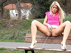 0  - Stunning blonde pisses outside on a bench