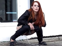 0  - Gorgeous redhead pisses in front of passing cars