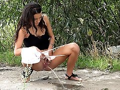 0  - Dark haired hottie is desperate to piss outside